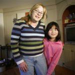 Genitori americani di bambini cinesi adottati sono allarmati per lo scandalo della melanina.
