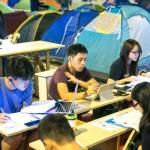Polizia di Hong Kong arresta i manifestanti con l'accusa di utilizzo improprio dei social media
